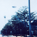 UFO Flies Over City Street