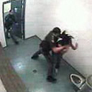 Photo: Caught On Tape: Cop Attacks Teen Girl In Cell