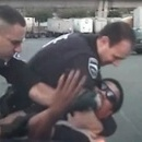 Cops hold man down and sic K-9 on him after beating him - for dancing in a parking lot